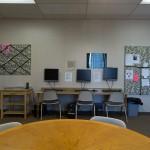 A computer room with 3 computer desks