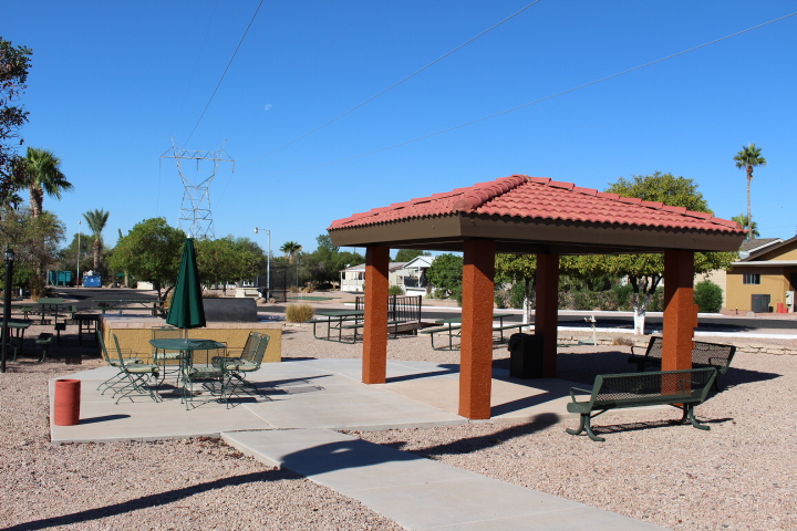 Outdoor BBQ area with picnic tables and benches