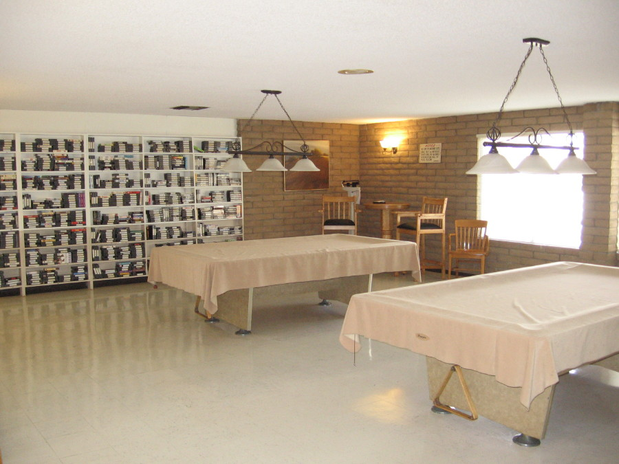 Large recreation room for residents to relax and enjoy time playing games, reading books, or watching movies. Includes multiple activities such as two available pool tables,
