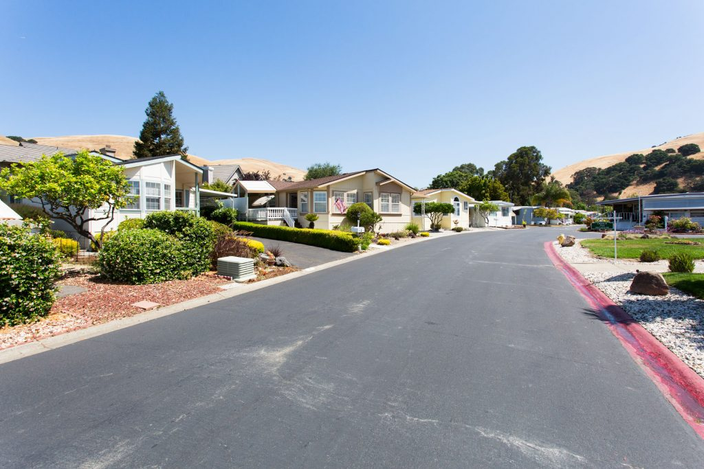 Beautiful manufactured homes line the wide, paved streets of the community. Each home has a unique character, with differing styles and front landscape.