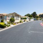 Wide, paved streets are lined with beautiful manufactured homes. Each home has a well-maintained, green front landscape