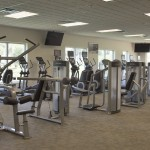 Fully equipped fitness center with weight machines and also TVs for enjoying while working out.