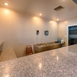 Inside the clubhouse, off the kitchen, is a bar top area with sink to utilize for events.