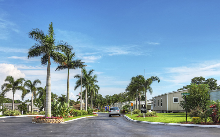 Village of Tampa, an all age manufactured home community, has wide clean paved streets with tall palm trees landscaped down the corridor as you enter in.