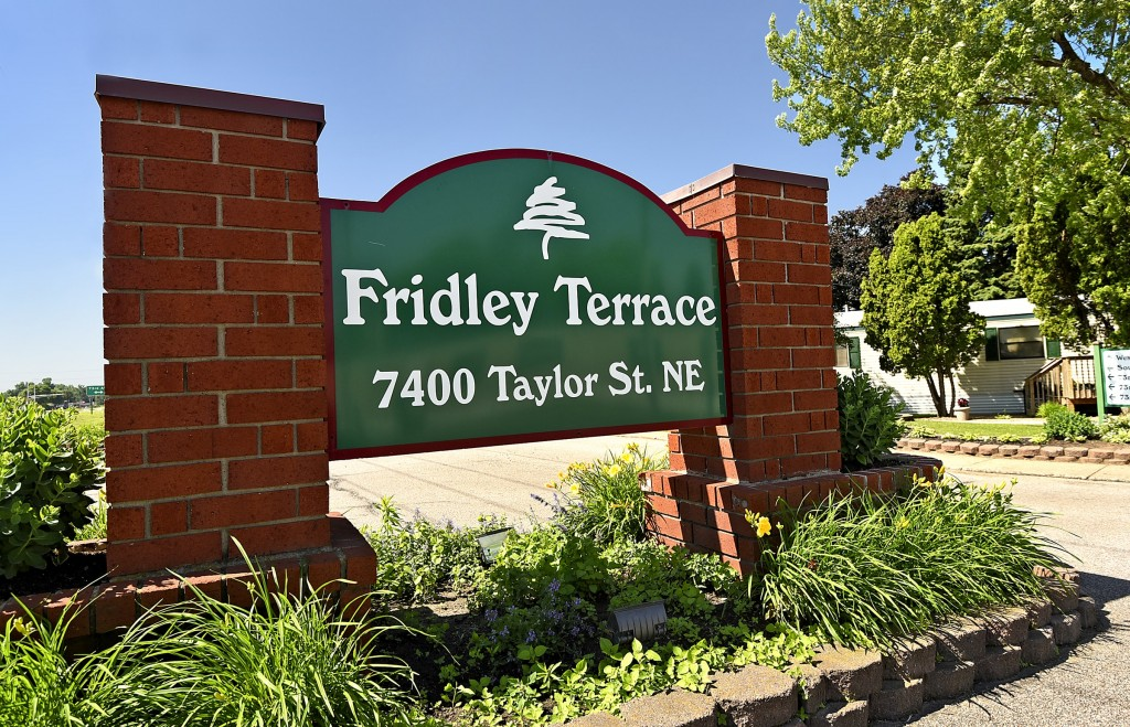 Fridley Terrace, an all age manufactured home community has a community sign in stone at the entrance with name and address.