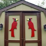 The residents of Rolling Hills Estates, an all-age manufactured home community, take pride in ownership of their homes. This shed has two beautiful red cardinal birds painted on the shed doors.
