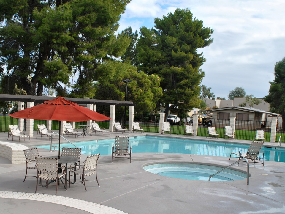 Chaparral Village, an all-age community, has a gated pool with jacuzzi and lounge chairs.