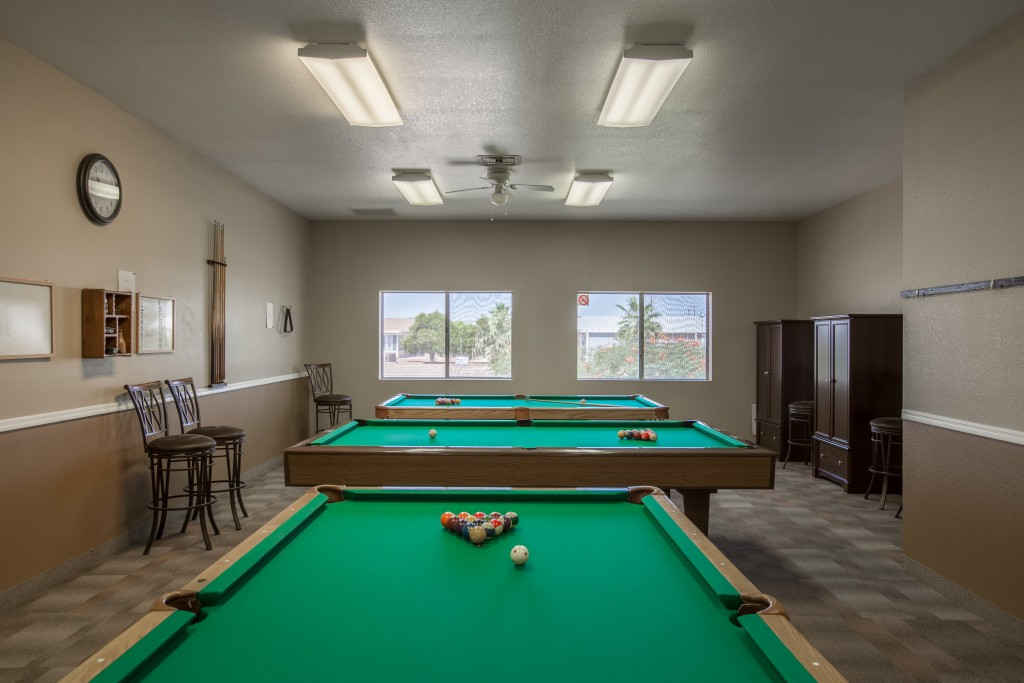 Billiards room with 3 pool tables.