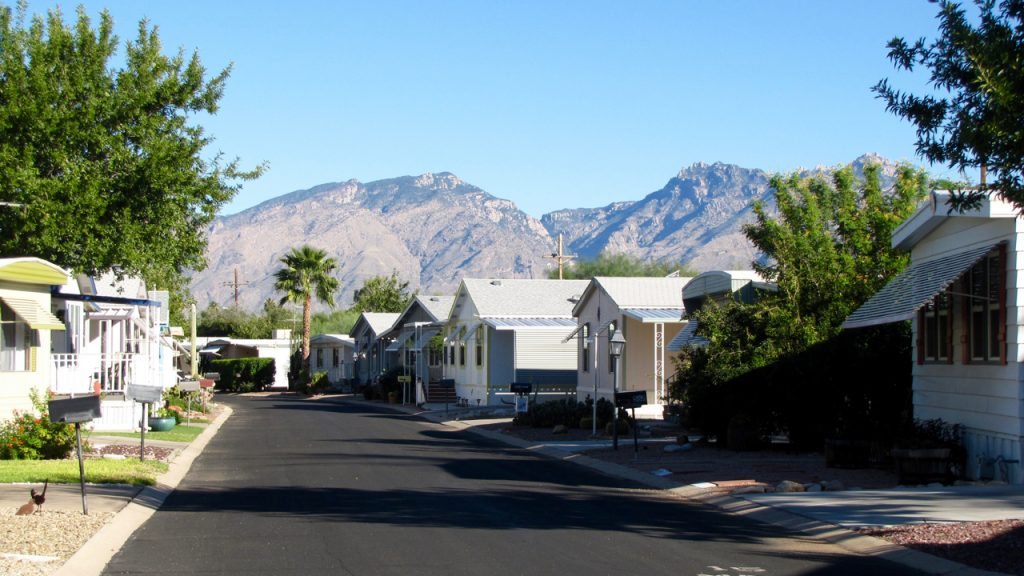 Clean, paved streets through the neighborhood with beautiful mountain scenery as the background.