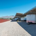 Large outdoor carport with multiple spaces for residents to park their RV's.