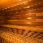 Large indoor sauna, fully enclosed by wood.