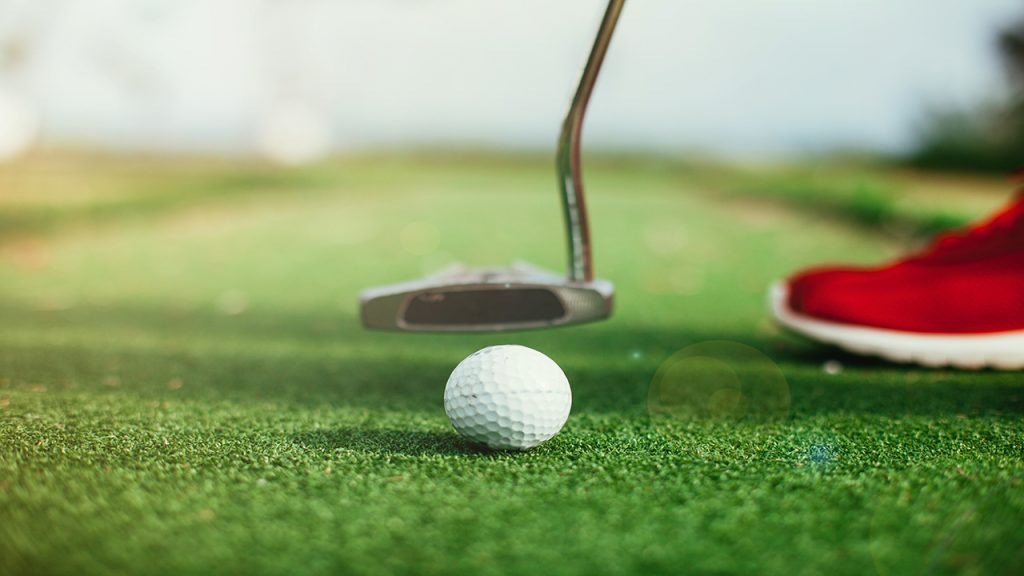 Playing golf at the putting green with driving area is an amenity of Far Horizons East in Tuscon, Arizona.