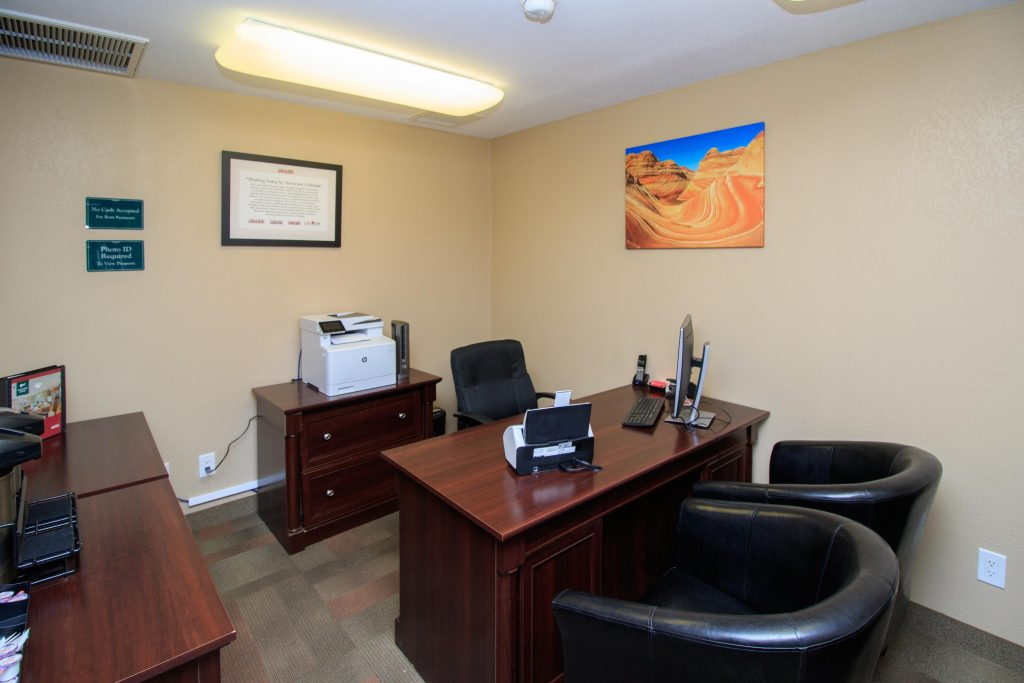Desk and seating within the leasing office. Small coffee stand for residents and potential buyers.