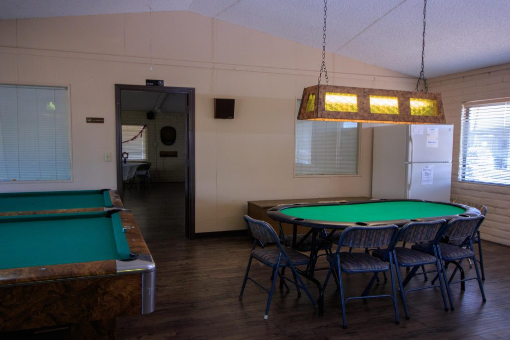 Poke table with enough seating for four. Adjacent to the billiard tables.