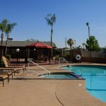 Community pool connected to the spa and surrounded by ample poolside seating.